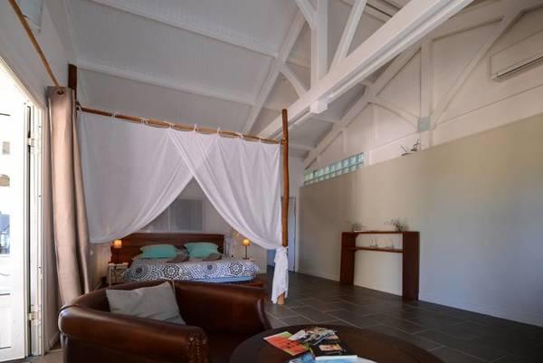 bungalow tartane ti turquoise salon lit moustiquaire